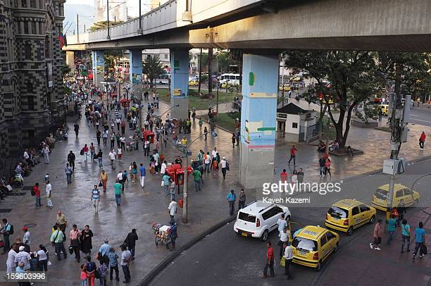 People and cars seen on the street in the city center on January 5 2013 in Medellin Colombia