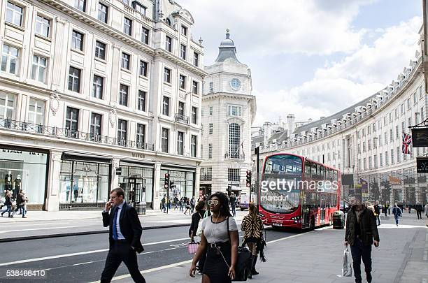 People and double-decker bus passing by Regent Street