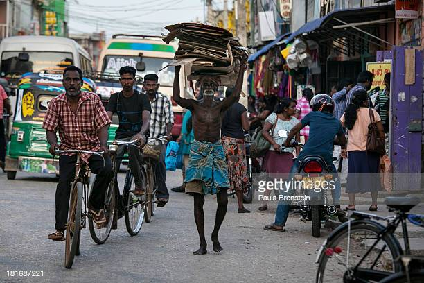 People and traffic move along in downtown Jaffna Sri Lanka July 9 2013 War's end has unleashed Sinhalese nationalism that has Tamils fearful of...