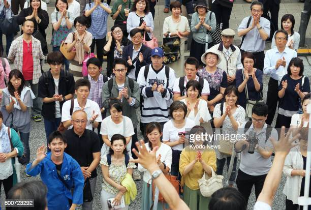 People applaud a candidate for the Tokyo metropolitan assembly during a stump speech in the capital's Meguro Ward on June 25 2017 The ruling Liberal...