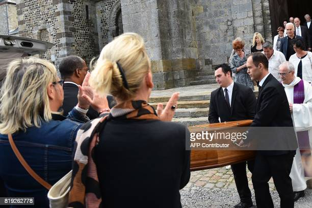 People applaud as men carry the coffin of French judge JeanMichel Lambert at the end of his funeral at the SaintJulien Cathedral in Le Mans...