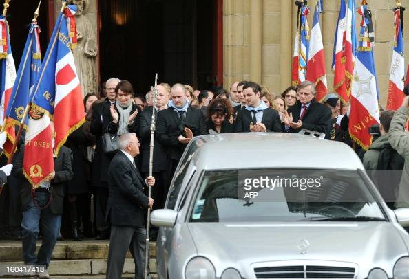 People applaud on January 31 2013 at the end of the funeral ceremony for French citizen Yann Desjeux killed in the hostage rescue operation at a...