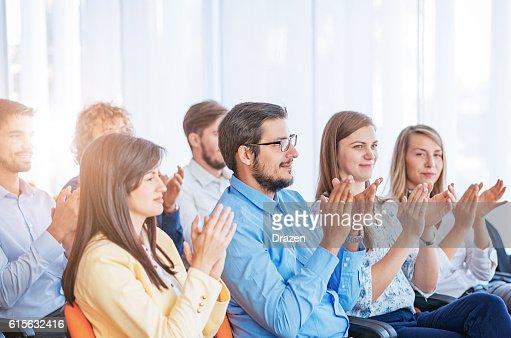 People applauding on seminar