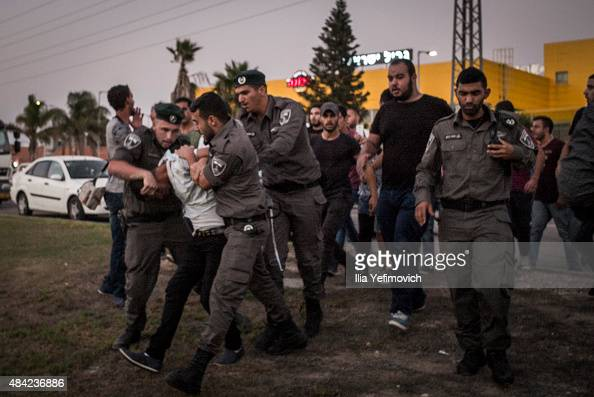 People are arrested during clashes that broke down as Palestinian activists from around Israel were trying to protest the force feeding of detainee...