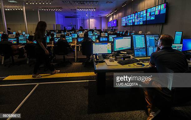 People are at work inside the International Broadcast Center during the Olympic Games Rio 2016 in Barra Olympic Park Rio de Janeiro on August 15 2016...