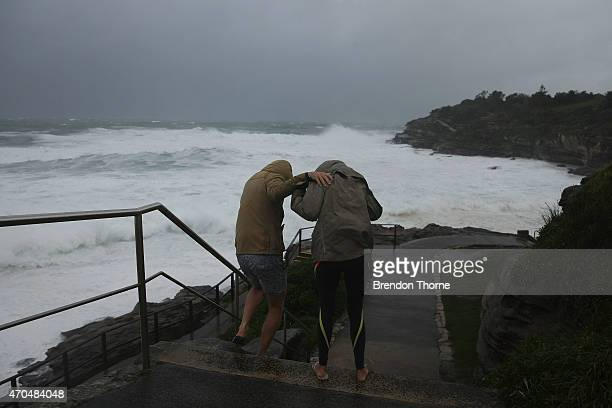 People are battered by strong winds at Bondi beach on April 21 2015 in Sydney Australia A second day of damaging winds and heavy rain have hit the...