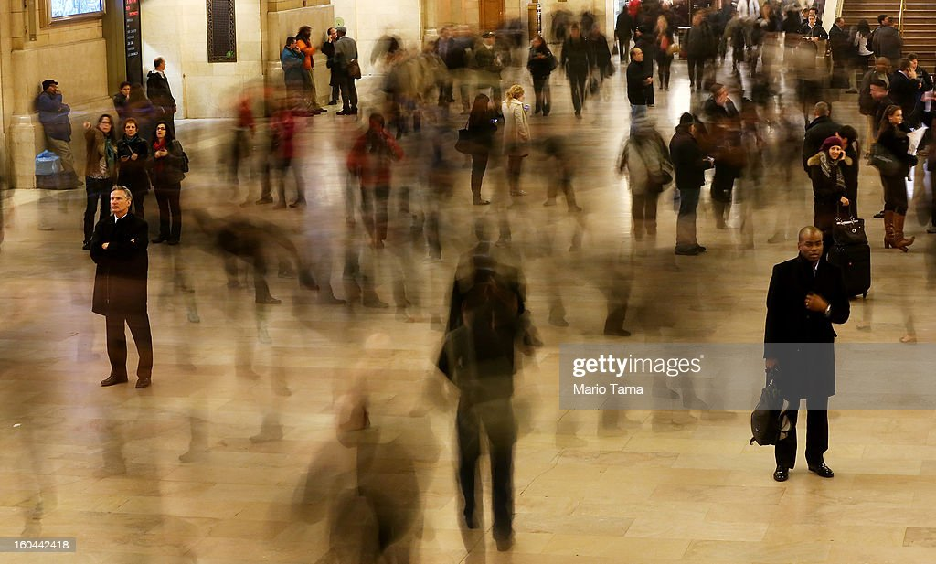 People are blurred in a long exposure as they walk through Grand Central Terminal on the day before the famed Manhattan transit hub turns 100 years old on January 31, 2013 in New York City. The terminal opened in 1913 and is the world's largest terminal covering 49 acres with 33 miles of track. Each day 700,000 people pass through the terminal where Metro-Noth Railroad operates 700 trains per day.