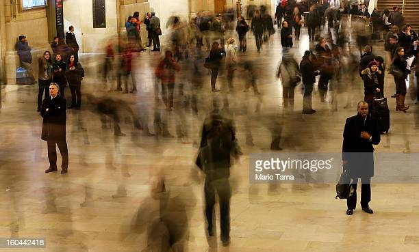 People are blurred in a long exposure as they walk through Grand Central Terminal on the day before the famed Manhattan transit hub turns 100 years...