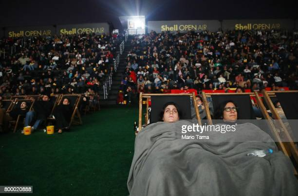 People are bundled up for the cold weather while watching the James Bond film Skyfall at the Shell Open Air cinema at Gloria Marina on June 22 2017...