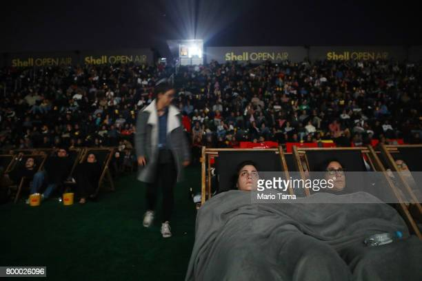 People are bundled up for the cold weather while watching the James Bond film 'Skyfall'at the Shell Open Air cinema at Gloria Marina on June 22 2017...