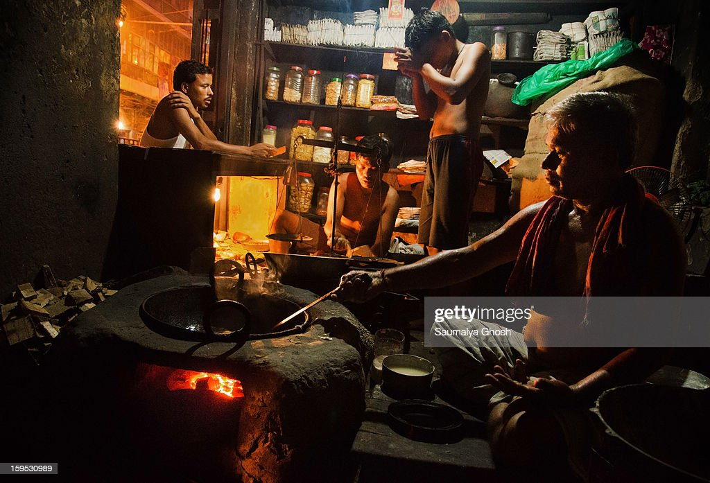 CONTENT] People are carrying out their everyday duties in a small food and grocery shop in the evening. One of them is attending customer and a boy is doing evening 'Aarti'. Another person is making 'Singara' and 'Alur Chop' which are great wonders of Bengal's culinary world.