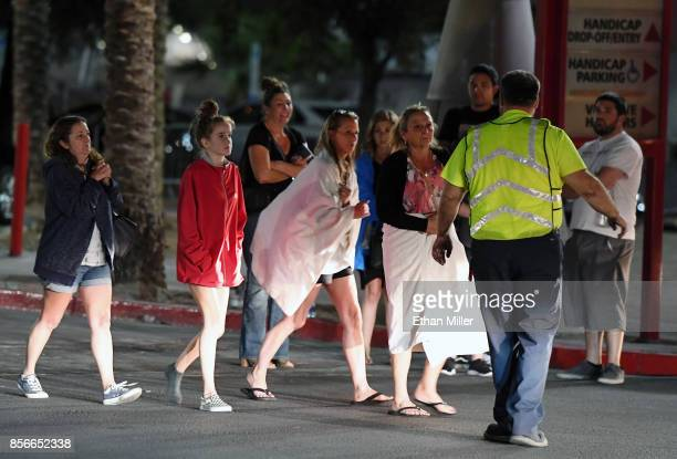 People are directed to rides outside the Thomas Mack Center after a mass shooting at a country music festival on October 2 2017 in Las Vegas Nevada...