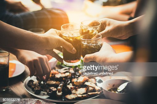 people are eating food ,drinking beverage together in party ,restaurant : Foto de stock
