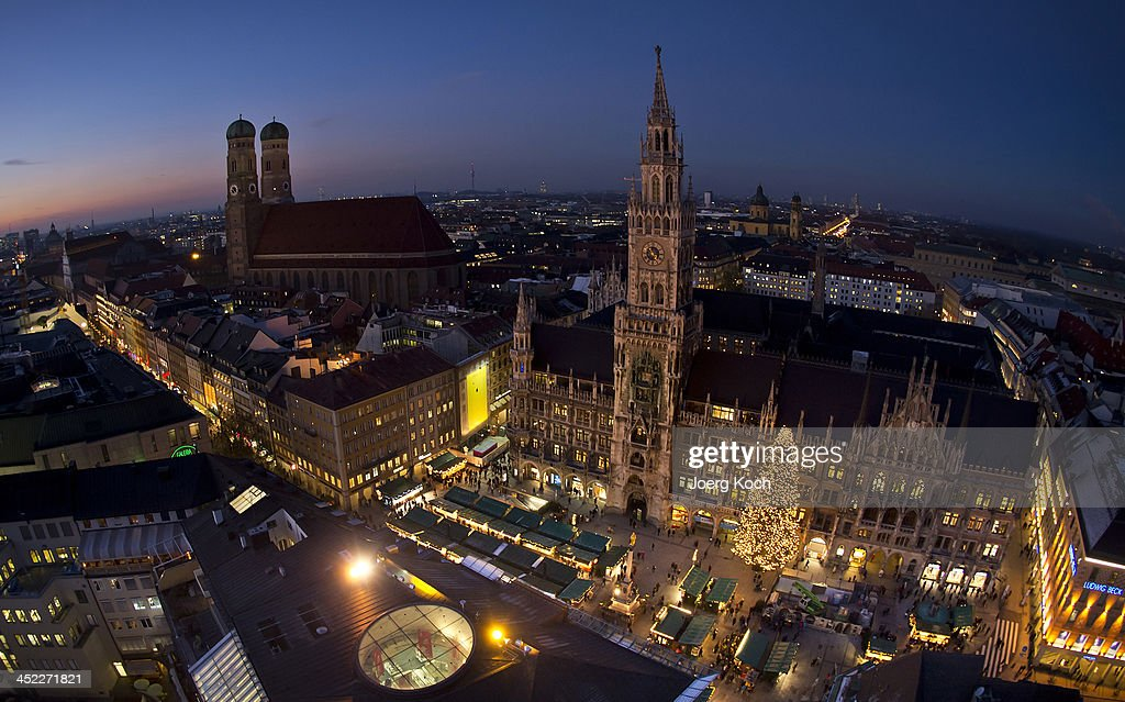 People are enjoying the colourful stalls and the glittering lights at the Munich Christmas Market on Marienplatz at November 27, 2013 in Munich, Germany. Christmas Markets opened all across Germany this week.