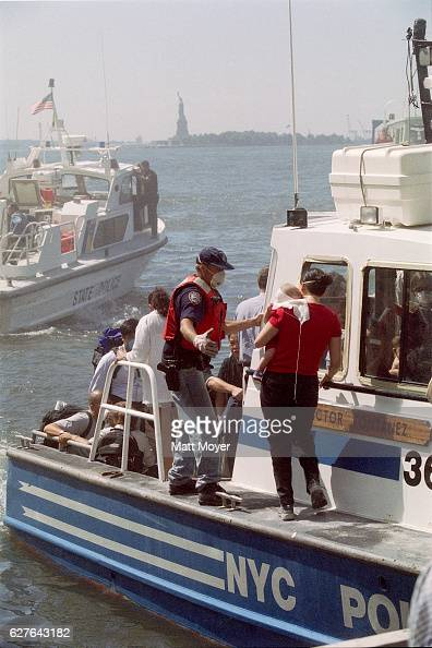People are evacuated by boat after the attack on the World Trade Center on September 11 2001