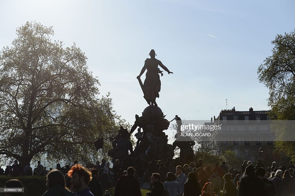 People are gathered on the Place de la Republiques during clashes between French anti riot police and protesters during a clash during the traditional May Day demonstration in Paris on May 1, 2016.
