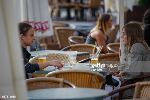 People are having drinks on the terrace of a bar set up on the old market square on 19 August in Bydgoszcz Poland