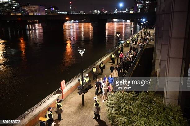 People are lead to safety away from London Bridge on June 4 2017 in London England Police have responded to reports of a van hitting pedestrians on...