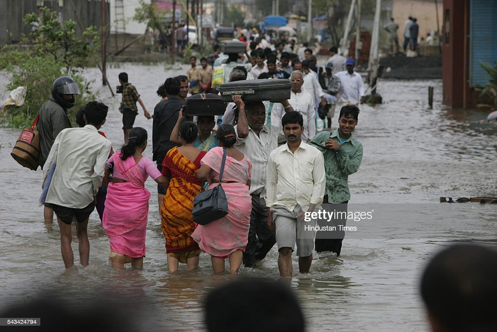 People are leaving their home and moving to a safer place as the water level start increasing again in Diva, near Dombivli on August 2, 2005 in Mumbai, India.