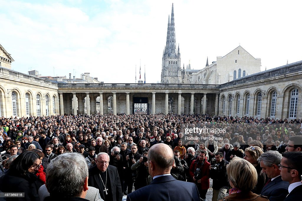 People are listenning Alain Juppe Mayor of Bordeaux in courtyard of Bordeaux's city hall before a minute's silence was observed for victims of the Friday's terrorist attacks in Paris on November 16, 2015 in Bordeaux, France. Countries across Europe joined France, currently observing three days of national mourning, in a one minute-silence in an expression of solidarity with the victims of terrorist attacks, which left at least 129 people dead and more hundred more injured.