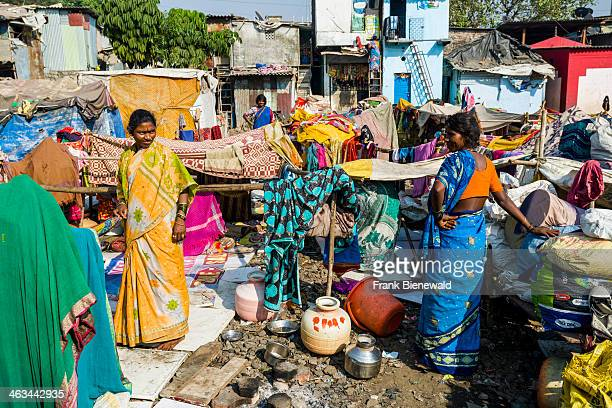 People are living in conditions of extreme poverty in huts made from iron sheets and blankets at Dharavi Slum the second largest slum area in Asia