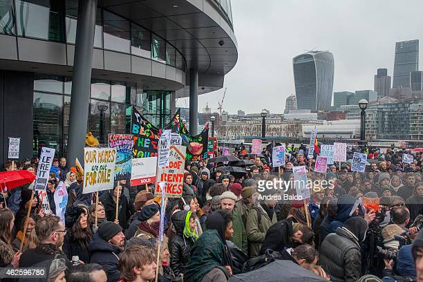 People are marching during the demonstration against housing issue in London from Shoreditch to the City Hall in Tower Bridge