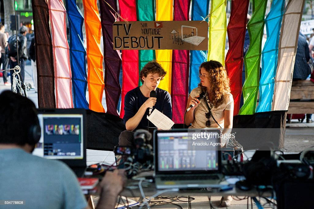 People are on the air at TV Debout, a TV show streaming in direct on internet from the Place the Republique in Paris in Paris, France on May 27, 2016.