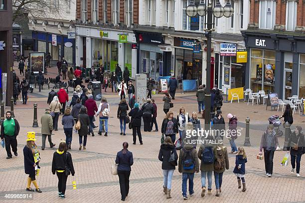 People are pictured on New Street in Birmingham City centre central England on March 14 2015 Expensive housing an overloaded transport system and a...