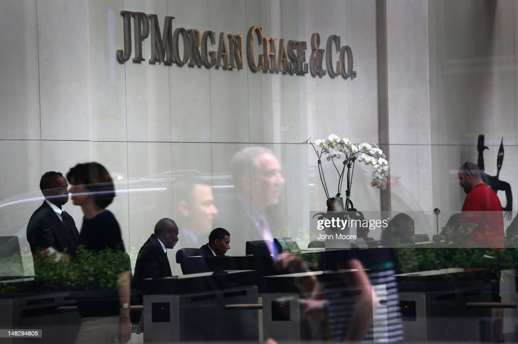 People are reflected in the window of the headquarters of JPMorgan Chase on Park Avenue in midtown Manhattan on July 13, 2012 in New York City. The bank, which reported its second-quarter results on Friday, disclosed that the losses on a credit bet could mount to more than $7 billion, as the nation's largest bank indicated that traders may have intentionally tried to conceal the extent of the loss. JPMorgan also said Friday that it would be forced to restate its first-quarter results.