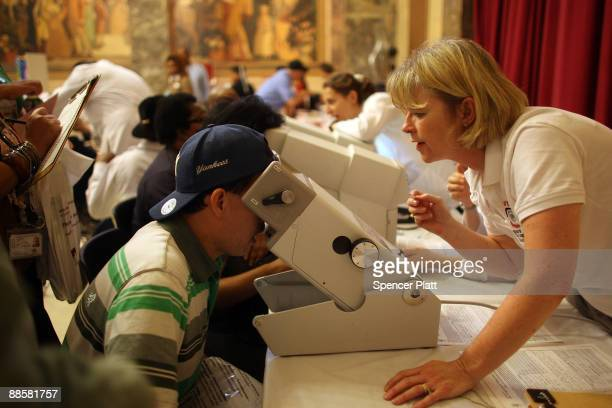 People are screened for glaucoma by eye doctors from the BronxLebanon Hospital at a health fair June 19 2009 in the Bronx borough of New York City...
