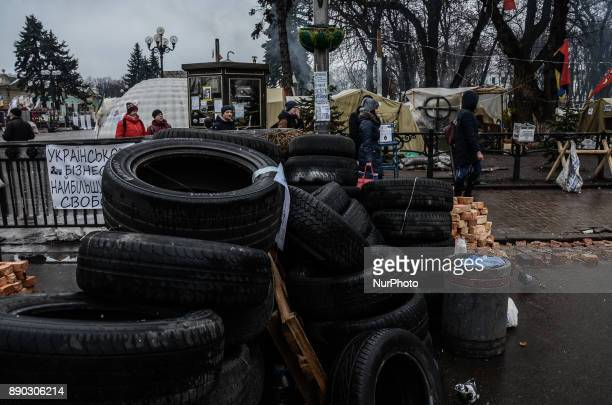 People are seeing walking near the Parliament tires barricade Thousands of supporters of the oppositional leader and former Georgian President...