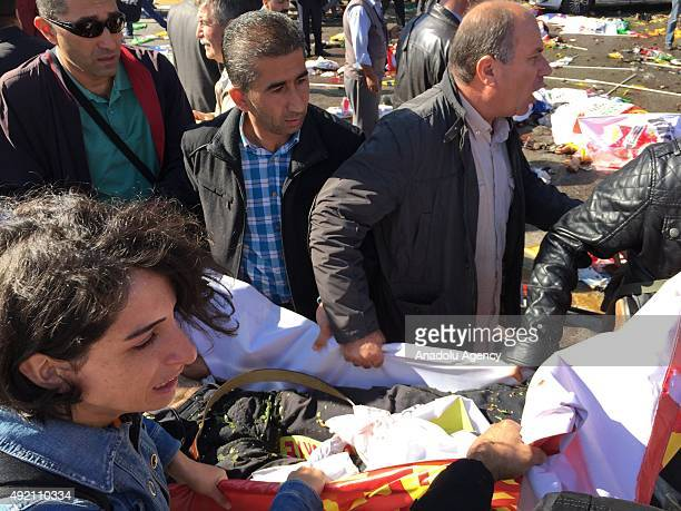 People are seen at the site of an explosion close to Ankara's main train station on October 10 2015 in Ankara Turkey An explosion hit Ankara train...