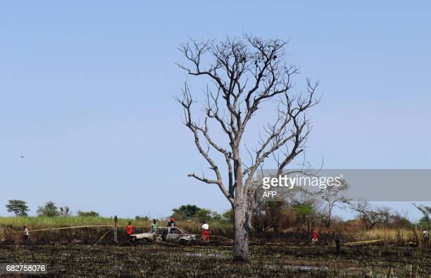 People are seen at the site of an explosion where four people died when trying to pierce a pipeline to steal oil in Tierra Blanca Veracruz State in...