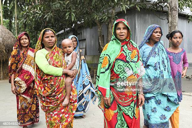 People are seen before they celebrate the solved enclaves conflict at Dashiachora in Kurigram enclaves Bangladesh on July 31 2015 Bangladesh and...