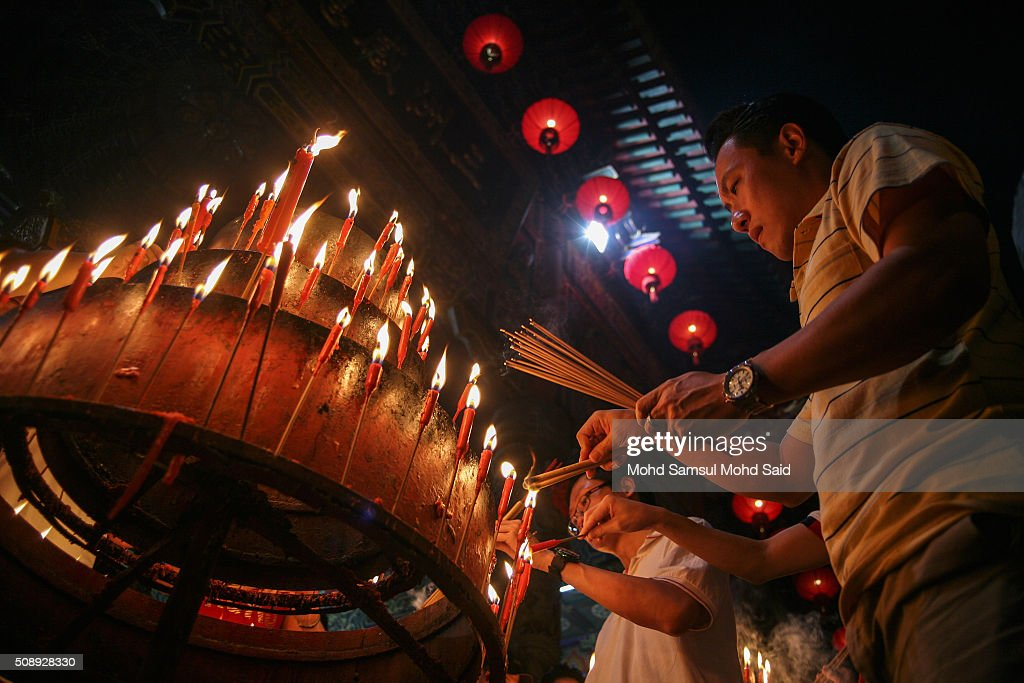 People are seen burning joss sticks as they offer prayers inside the Guan Yin temple ahead of Lunar New Year of the monkey celebrations on February 7, 2016 outside Kuala Lumpur, Malaysia. According to the Chinese Calendar, the Lunar New Year which falls on February 8 this year marks the Year of the Monkey, the Chinese Lunar New Year also known as the Spring Festival is celebrated from the first day of the first month of the lunar year and ends with Lantern Festival on the Fifteenth day.