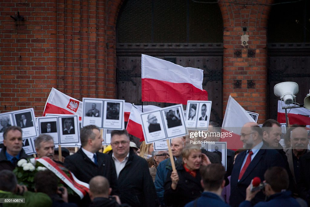 People are seen commemorating the crash of the government Tupolev aircraft in Smolensk Russia which killed several dozen prominent government...