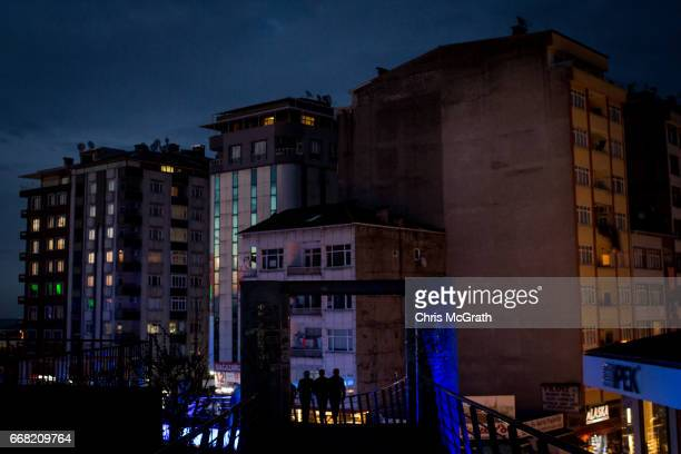 People are seen crossing a bridge on April 10 2017 in Rize Turkey Although born in Kasimpasa Istanbul President Erdogan's family was originally from...