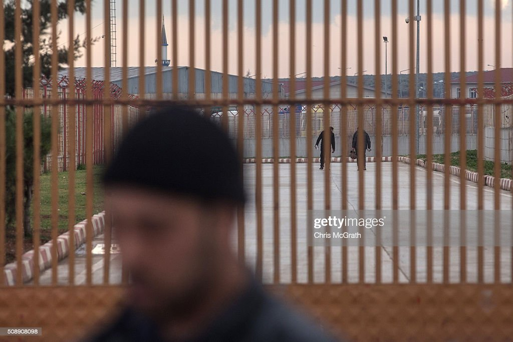 People are seen crossing to Syria after being allowed to enter the closed Turkish border gate on February 7, 2016 in Kilis, Turkey. According to Turkish officials some 35,000 Syrian refugees have massed on the Syrian/Turkish border after fleeing Russian airstrikes and a regime offensive surrounding the city of Aleppo in northern Syria.