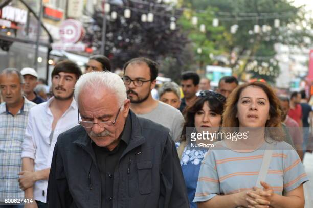 People are seen during a march in support of sacked academic Nuriye Gulmen and primary school teacher Semih Ozakca in Ankara Turkey on June 24 2017...