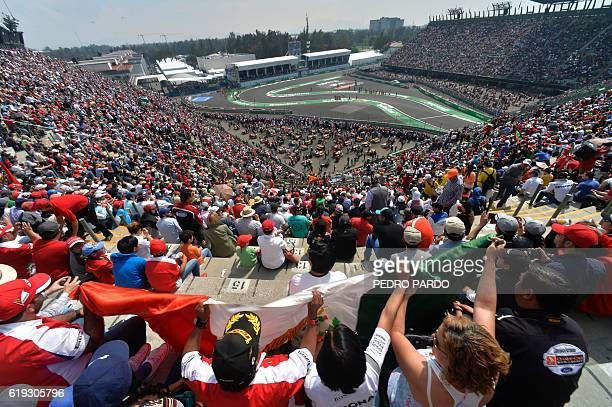 TOPSHOT People are seen during the Formula One Mexico Grand Prix at the Hermanos Rodriguez circuit in Mexico City on October 30 2016 Lewis Hamilton...