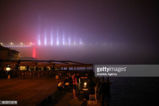 People are seen during the heavy mist in Istanbul Turkey on July 27 2017