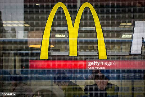 People are seen eating in a McDonalds restaurant on April 17 in Tokyo Japan McDonald's Holdings Co announced on April 16 2015 that it expects to post...