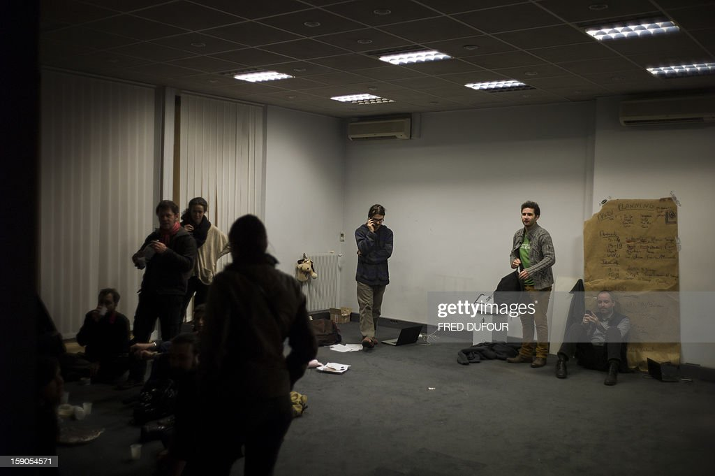 People are seen in a room they occupied a building requisitioned by French associations 'Jeudi Noir' ('Black Thursday') and 'Droit Au Logement', ('Right to Housing Association', DAL), on January 6 , 2013 in Paris. The building, situated in the 10th arrondissement of Paris is occupied since December 31, 2012.
