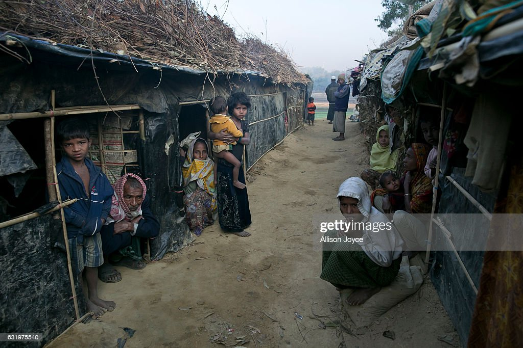 People are seen in Kutapalong unregistered camp on January 18, 2017 in Coxs Bazar, Bangladesh. More than 65,000 Rohingya Muslims have fled to Bangladesh from Myanmar since October last year, after the Burmese army launched a campaign it calls 'clearance operations' in response to an attack on border police on October 9, believed to have been carried out by Rohingya militants. Waves of Rohingya civilians have since fled across the border, most living in makeshift camps and refugee centers with harrowing stories on the Burmese army committing human-rights abuses, such as gang rape, arson and extrajudicial killing. The Rohingya, a mostly stateless Muslim group numbering about 1.1 million, are the majority in Rakhine state and smaller communities in Bangladesh, Thailand and Malaysia. The stateless Muslim group are routinely described by human rights organizations as the 'most oppressed people in the world' and a 'minority that continues to face statelessness and persecution.'