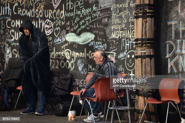 People are seen in Martin Place which has become known as 'Tent City' as homeless people set up camp in the central business district of Sydney on...