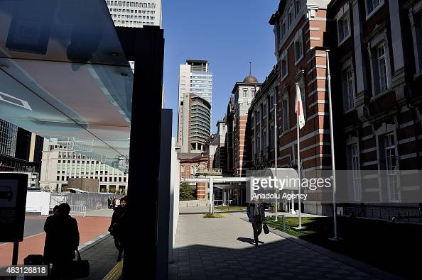 People are seen in the middle of buildings of the financial and business of Marunouchi in Tokyo Japan on February 10 2015 Japanese Prime Minister...