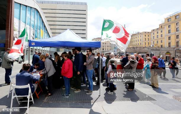 People are seen in the queue at a polling station for the primary elections of the Italian Democratic Party leadership in Rome Italy on April 30 2017...