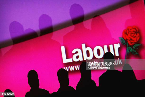 People are seen infront of a party logo during the Labour Party Annual Conference on September 26 2004 in Brighton England