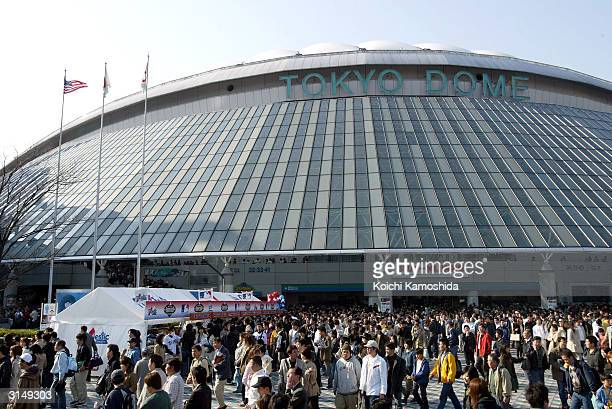 People are seen leaving the Tokyo Dome after watching an exhibition game between the Tampa Bay Devil Rays the Hanshin Tigers March 28 2004 at Tokyo...