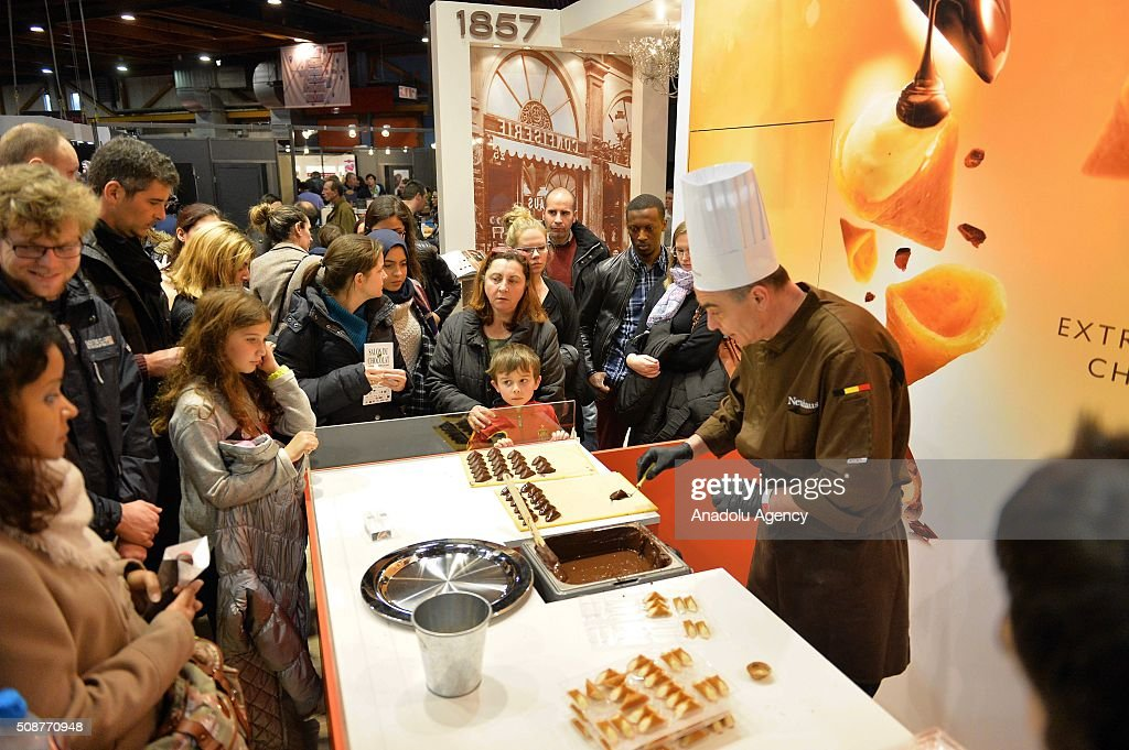 People are seen near the stalls as pieces of chocolate are displayed at the Brussels Chocolate Fair, also known as Salon Du Chocolat, in Brussels, Belgium, on February 6, 2016. The Salon du Chocolat is a yearly trade fair for the international chocolate industry.